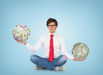man holding ball of money