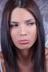 Young brunette woman making face expression