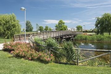 Italy, Caorle rest area with a pond and a bridge