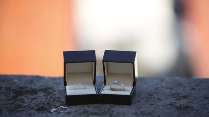 Wedding rings in the boxes on the balcony an exotic city