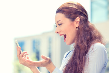 Side profile surprised excited young girl looking at phone