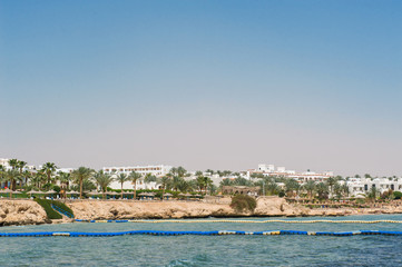 Panorama of white city and the blue sea with a coast line Sharm