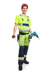 Young contractor holding electric screwdriver and walkie-talkie