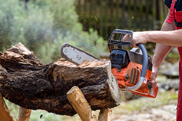 Man cutting lumber with chainsaw