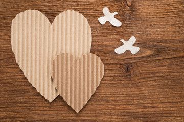 Hearts and birds made of cardboard