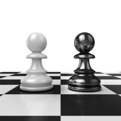 Two chess pawns, black and white figures on board