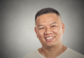 headshot portrait of middle aged man happy smiling