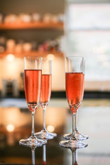 Pink Champagne flute glasses on a table