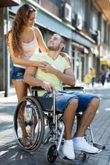 Woman and man in wheelchair