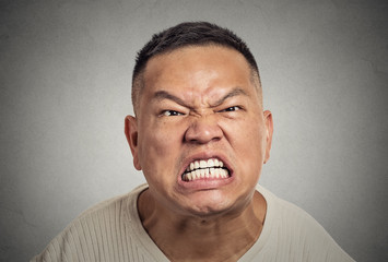headshot angry middle aged man with open mouth screaming