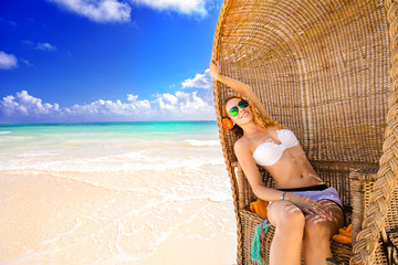 woman young lady with sunglasses relaxing on tropical beach