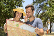 Happy tourist couple with map