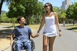 man in wheelchair and girlfriend
