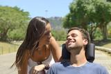 Paraplegic man in wheelchair and girfriend