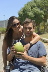 couple drinking coconut water