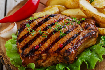 Grilled steak on the bone with potatoes