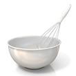 Leinwandbild Motiv Bowl with a wire whisk, isolated on white