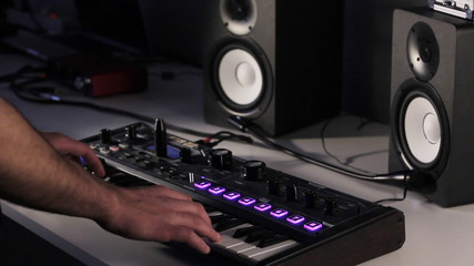 DJ using his midi controller
