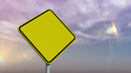 Empty yellow road sign against changing sky