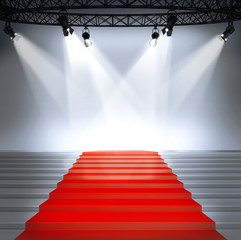 Stairs with red carpet and with spotlights