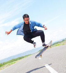 skater playing skateboard with flipping trick