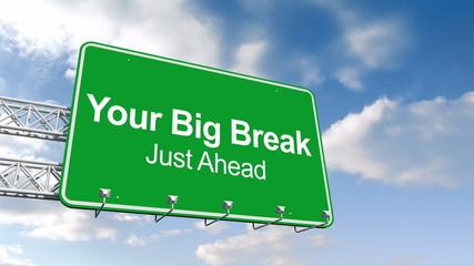 Your big break sign against blue sky