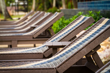 sunbeds beside swimming pool