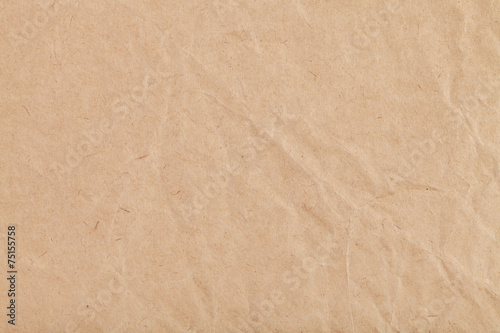 background from sheet of crumpled kraft paper