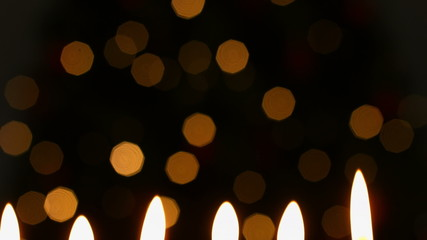 Candles burning at christmas time