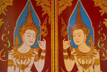 traditional Thai style art painting on wall in door ,Thailand