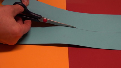 artist hands clip with scissors colorful paper