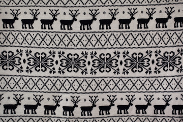 knitted pattern with deer and snowflakes