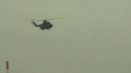 View of flying helicopter in cloudy sky