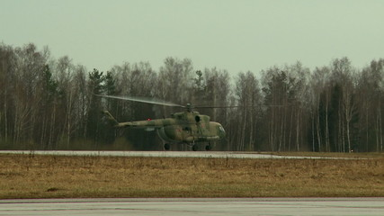 Military helicopter lands on airstrip