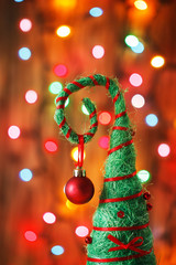 handmade Christmas tree decoration against lights blurred backg