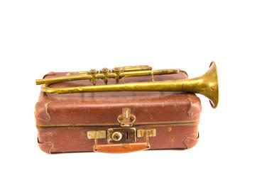 brass retro wind instrument trumpet on old case