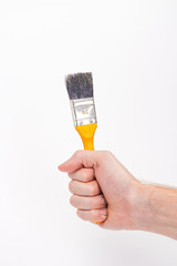 male hand with a yellow brush