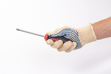 isolated male gloved hand holding a screwdriver