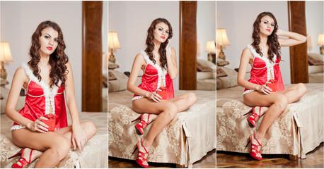 Young sexy Santa holding a gift, boudoir shoot. Attractive girl