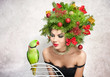 Beautiful girl with Xmas hairstyle an green parrot