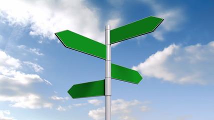 Green signpost against blue sky