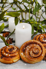 Cinnamon buns, mistletoe and candles