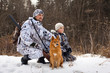 the hunter with his son and their dog - 75161187
