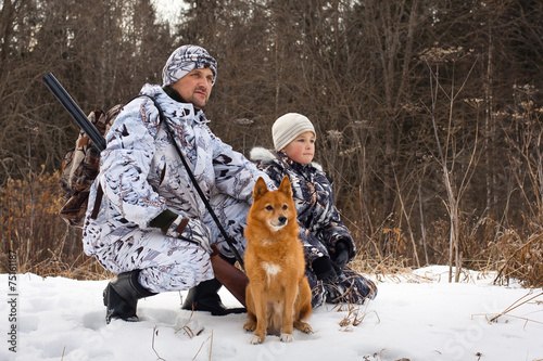 Tuinposter Jacht the hunter with his son and their dog