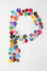 Letter P of the alphabet of buttons of various shapes and colors