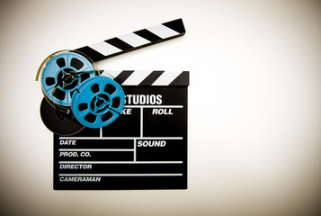 Clapper board and 8mm film reels color effect