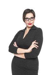 Beautiful plus size woman in black dress and glasses posing