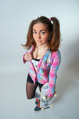 Young female holding a skateboard in her heand