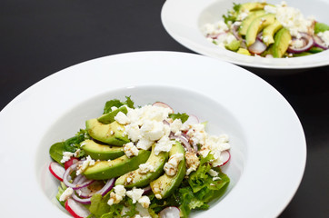 Avocado salad with goat cheese, lettuce and radish