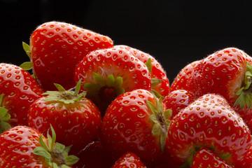 heap of strawberrys on black